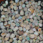 ASFAW KIDANE Ethiopian Wolo Opal & Emerald Gemstone Export